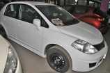 Nissan Tiida. БЕЛЫЙ (QM1)